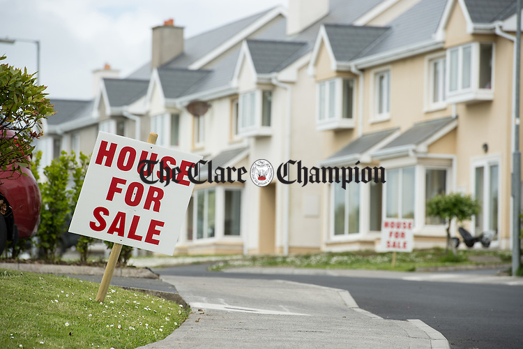 """A view of of some of the """"For Sale"""" signs erected outside houses in the Beal An Inbhir estate at in Kilrush. Photograph by John Kelly."""