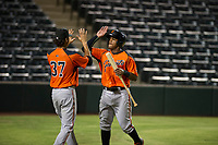 AZL Giants center fielder Heliot Ramos (31) is congratulated by Francisco Medina (37) after scoring during a game against the AZL Angels on July 9, 2017 at Diablo Stadium in Tempe, Arizona. AZL Giants defeated the AZL Angels 8-4. (Zachary Lucy/Four Seam Images)
