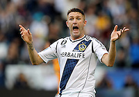 CARSON, CA - DECEMBER 01, 2012:   Robbie Keane (7) of the Los Angeles Galaxy complains about the referee's decision against the Houston Dynamo during the 2012 MLS Cup at the Home Depot Center, in Carson, California on December 01, 2012. The Galaxy won 3-1.
