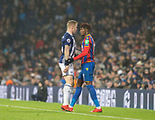 2nd December 2017, The Hawthorns, West Bromwich, England; EPL Premier League football, West Bromwich Albion versus Crystal Palace; Wilfred Zaha of Crystal Palace and James McClean of West Bromwich Albion confront each other after a tackle