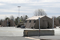 LANDOVER, MD - MARCH 21:  Members of the National Guard set up tents in the parking lots of FEDEX field in Landover, Maryland in preparation of the upcoming COVID-19 testing possibilities on March 21, 2020. <br /> CAP/MPI34<br /> ©MPI34//Capital Pictures
