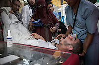 In this Friday, Aug. 09, 2013 photo, a supporter of the ousted president Mohammed Morsi receives medical emergency care in a makeshift hospital in the sit-in at streets nearby Al-Raba'a Alawya mosque in the Nasr district of Cairo. (Photo/Narciso Contreras).