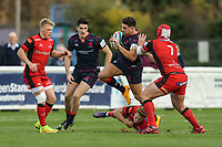 Ben Mosses of London Scottish looks to avoid the tackle  during the Greene King IPA Championship match between London Scottish Football Club and Hartpury RFC at Richmond Athletic Ground, Richmond, United Kingdom on 28 October 2017. Photo by David Horn.