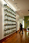 A staffer walks passed a display of earthenware jars in the lobby of the Imperial Palace (IP) Boutique Hotel in Itaewon, Yongsan district of of Seoul, South Korea on 25 June 2010..Photographer: Rob Gilhooly