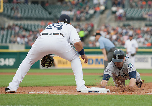 June 09, 2011:  Seattle Mariners first baseman Adam Kennedy (#4) dives back into base as Detroit Tigers first baseman Miguel Cabrera (#24) awaits throw in game action during MLB game between the Seattle Mariners and the Detroit Tigers at Comerica Park in Detroit, Michigan.  The Tigers defeated the Mariners 4-1.