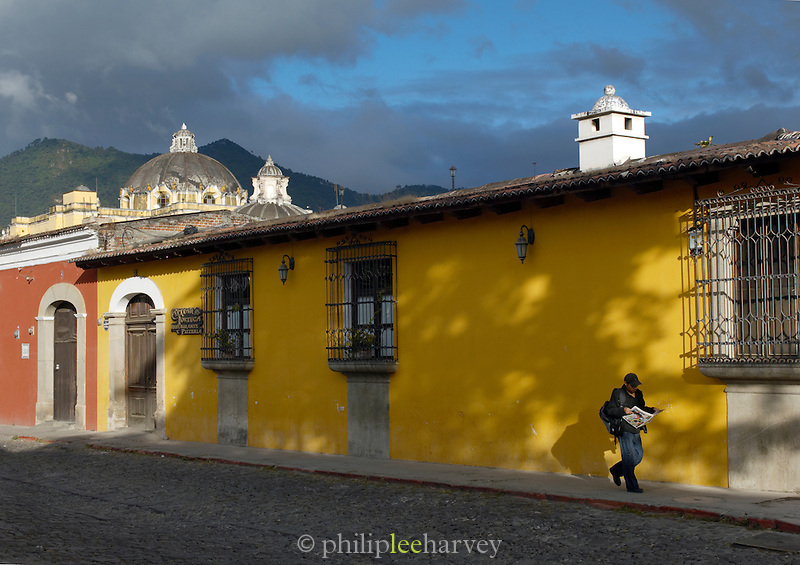 Local man reading a newspaper in Antigua, a UNESCO World Heritage Site in Guatemala