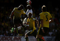 Andre Ayew of Swansea battles with Ikechi Anya of Watford   during the Barclays Premier League match Watford and Swansea   played at Vicarage Road Stadium , Watford