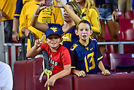Landover, MD - SEPT 24, 2016: Two young West Virginia Mountaineers fans celebrate following the teams 35-32 win against BYU at FedEx Field in Landover, MD. (Photo by Phil Peters/Media Images International)