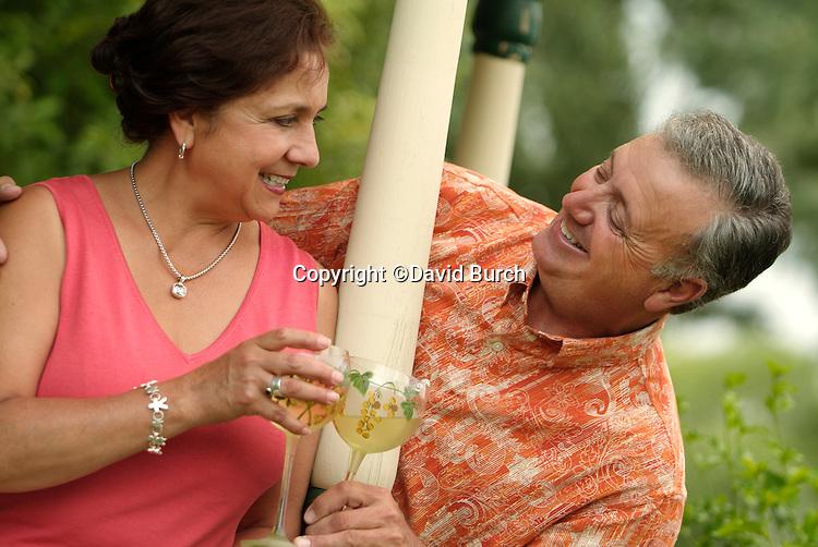 Hispanic man and woman toasting