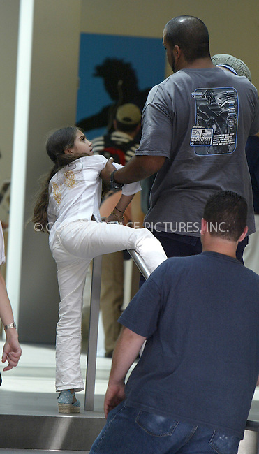 Madonna's daughter, Lourdes Leon, was seen having sone fun at Apple Store in SoHo as she climbed over hand-rail. Unfortunately, Lola's fun did not last too long, as her carer came over and yanked Lola away. New York, July 9, 2004...Please byline: PHILIP VAUGHAN/ACEPIXS.COM   .. *** ***  ..All Celebrity Entertainment, Inc:  ..contact: Alecsey Boldeskul (646) 267-6913 ..Philip Vaughan (646) 769-0430..e-mail: info@acepixs.com