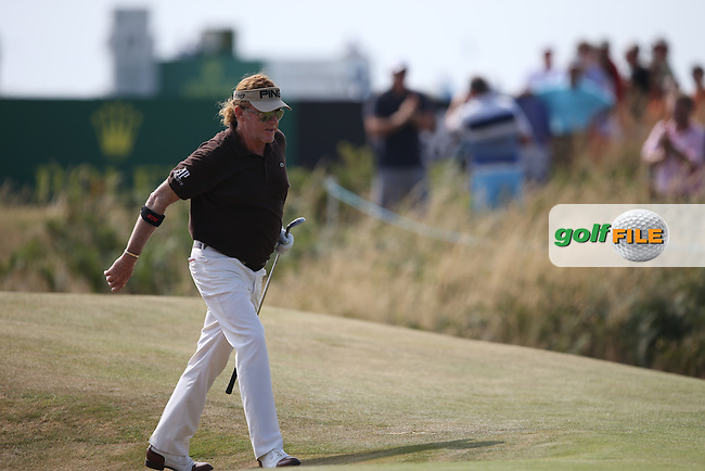 Miguel Angel Jimenez (ESP) finds the back bunker on the 11th but sinks it straight into the hole to delight the crowds during Round Three of the 2014 Senior Open Championship presented by Rolex from Royal Porthcawl Golf Club, Porthcawl, Wales. Picture:  David Lloyd / www.golffile.ie