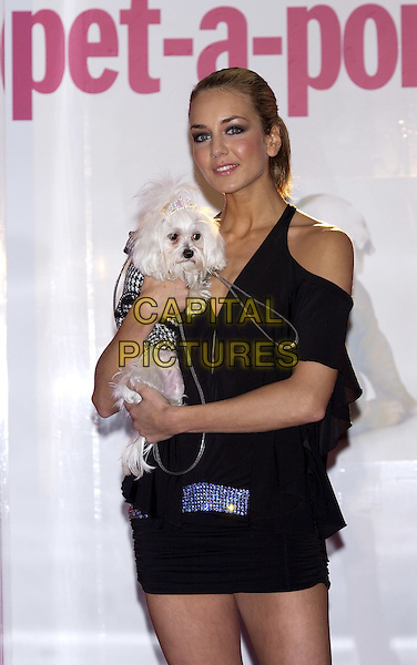 LADY ISABELLA HERVEY.Pet-a-Porter 2004, Harrods, Knightsbridge, London.October 27th, 2004.Lady Isabella wear Jasmine De Milo dress, Cleao wears tweed coat by Puppia, bone tiara from Fox & Hounds, gold collar with Swarovski crystal an lead by Majestic.half length, black, dog, animal, pet.www.capitalpictures.com.sales@capitalpictures.com.©Capital Pictures