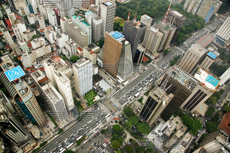 Flying over Avenida Paulista, the city's commercial heart, with its high concentration of helipads..Helicopter pilots serving the growing number of flying businessmen report that often they are requested to pick a passenger in one helipad at the top of a skyscraper and land across the road. Top executives claim they have too much to risk by moving around the city overland, due to the time spent in endless traffic jams to the very real risk of kidnapping..
