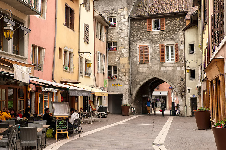 Diners in small outdoor cafes enjoy the quiet, traffic-free streets of old town in Annecy.
