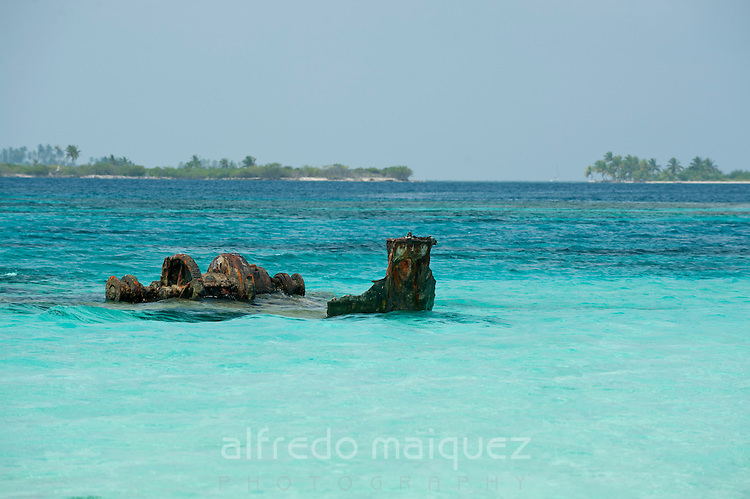 Sunken boat partially viewed near the shore. San Blas Archipelago, Panama, Caribbean, Central America.