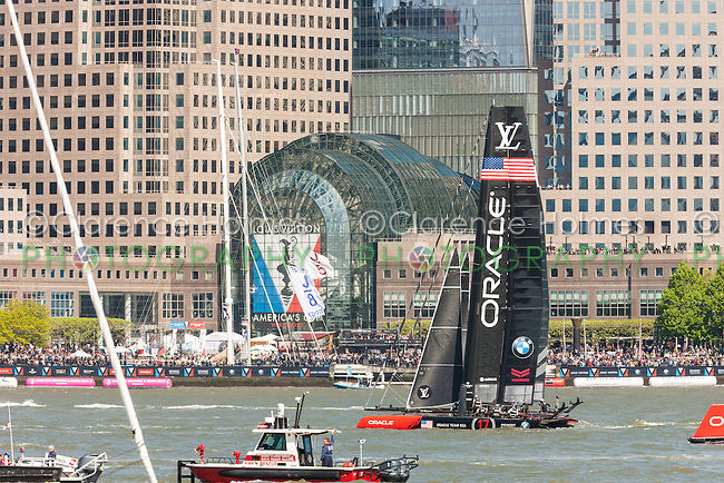 The Oracle Team USA catamaran races on the Hudson River near Brookfield Place in the Louis Vuitton America's Cup World Series.