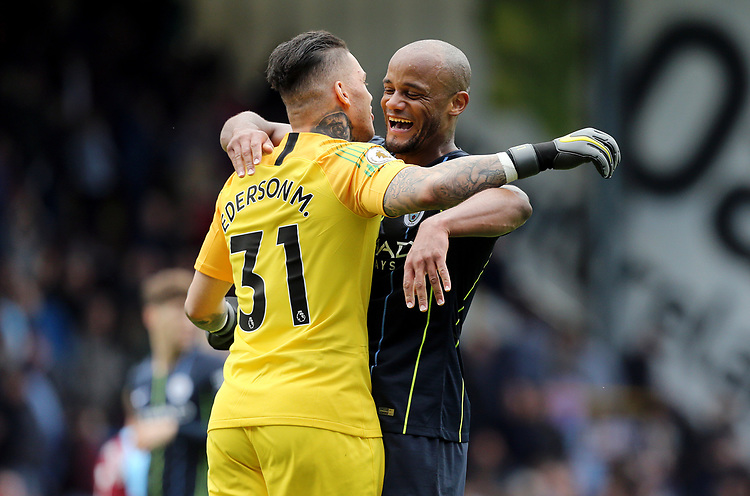 Manchester City's Ederson and Vincent Kompany celebrate victory at the final whistle<br /> <br /> Photographer Rich Linley/CameraSport<br /> <br /> The Premier League - Burnley v Manchester City - Sunday 28th April 2019 - Turf Moor - Burnley<br /> <br /> World Copyright © 2019 CameraSport. All rights reserved. 43 Linden Ave. Countesthorpe. Leicester. England. LE8 5PG - Tel: +44 (0) 116 277 4147 - admin@camerasport.com - www.camerasport.com