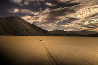 Moving Rocks slide along the smooth surface of Racetrack Playa at Death Valley National Park, California