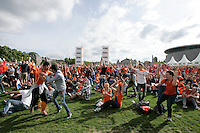Fans celebrate a Dutch goal against Austrialia on the Museum Square on June 18, 2014 in Amsterdam Netherlands. The Netherlands defeated Australia 3-2. - Photo by Paulo Amorim