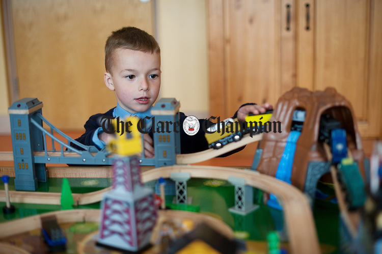 Lee Freeman, busy with a toy train at Ballycar National School. Photograph by John Kelly.
