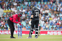 Kumar Dharmasena fixes the wickets under the watchful eye of Martin Guptill (New Zealand) during India vs New Zealand, ICC World Cup Warm-Up Match Cricket at the Kia Oval on 25th May 2019