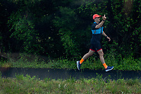 A jogger points his middle finger at the presidential motorcade carrying United States President Donald J. Trump as he he travels to Trump National Golf Club in Sterling, Virginia on Saturday, May 23, 2020.  Credit: Stefani Reynolds / CNP/AdMedia
