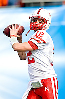 January 1, 2009:       Nebraska quarterback Joe Ganz (12) warms up prior to the start of the 64th annual Konica Minolta Gator Bowl between the Nebraska Cornhuskers  and the Clemson Tigers  at Jacksonville Municipal Stadium in Jacksonville, Florida. Nebraska defeated Clemson 26-21.