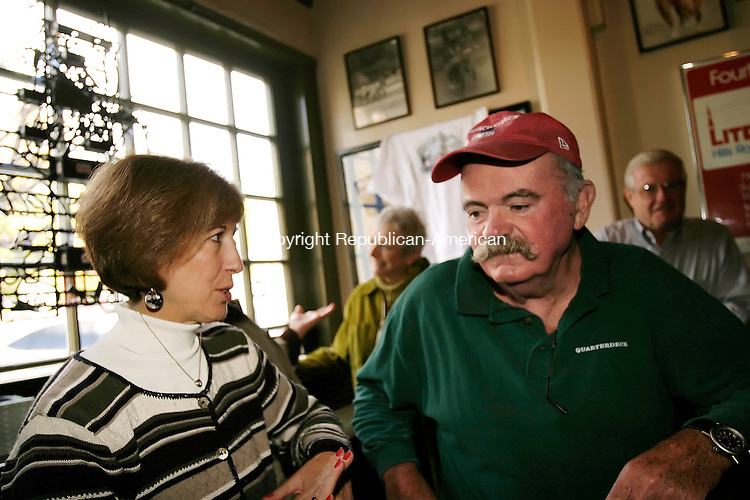 """LITCHFIELD, CT - 23 OCTOBER 2005 -102305JS03- Author Kathleen Cleary. left, talks with Tommy Leonard, right, during a book signing Sunday at The Village Restaurant in Litchfield. Cleary's book """"If This Is Heaven, I Am Going Go Be A Good Boy; The Tommy Leonard Story"""" is the life story of Leonard, know as the Offical Greeter of the Boston Marathon and also helped to get the Litchfield Road Race started.   --Jim Shannon Republican-American--Kathleen Cleary; Tommy Leonard; The Village Restaurant; Litchfield are CQ"""