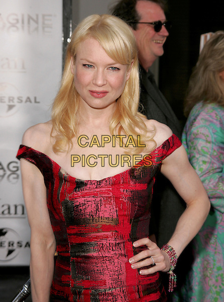 "RENEE  ZELLWEGER.Universal Pictures' World Premiere of ""Cinderella Man"" held at The Universal City Walk in Universal City, California .May 23rd, 2005.half length red dress off the shoulder beaded bracelet ring hand on hip.www.capitalpictures.com.sales@capitalpictures.com.Supplied By Capital PIctures"