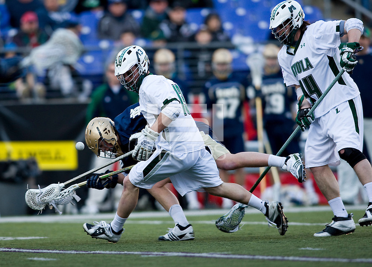 Michael Crimmins (13) of Loyola collides with Neal Hicks (11) of Notre Dame on a groundball during the Face-Off Classic in at M&T Stadium in Baltimore, MD