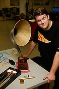 Johnathan Danforth and his creation, The Danforth Standard Digitrola, which plays MP3s through a phonograph, at the Durham TechShop.