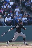 Nick Torres #10 of the Cal Poly Mustangs bats against the UCLA Bruins at Jackie Robinson Stadium on February 22, 2014 in Los Angeles, California. Cal Poly defeated UCLA, 8-0. (Larry Goren/Four Seam Images)