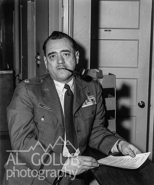 Maj. George Herkert director of Information. <br /> <br /> <br /> March 1964: CAFB, California<br /> Staff of the Valley Bomber, 93rd Bomb Wing, Directory of Information, SAC<br /> Photo by Al Golub/Golub Photography<br /> <br /> Castle is named for Brigadier General Frederick W. Castle, who died on Dec. 24, 1944 flying his 30th bombing mission. He died leading an armada of 2000 B-17s on a strike against German airfields. On the way to the target, an engine failure over Liege, Belgium caused his bomber to fall behind, where it was attacked by Germans and caught fire. He ordered his men to bail out but stayed alone at the controls of the flaming Flying Fortress until it crashed. The entire crew, except Gen. Castle and one airman killed before the bailout order, survived. Gen. Castle received a Medal of Honor posthumously for his bravery.<br /> <br /> Castle became home to the 93rd Bombardment Wing in 1947. Aircraft stationed at Castle included B-29, B-17 and C-54 aircraft, with B-50 bombers arriving in 1949. In 1954, B-47 bombers arrived.  On June 29, 1955, Castle received the Air Force's first B-52. These heavy bombers can hold the equivalent of three railroad cars' worth of fuel. The first Air Force KC-135 jet tanker arrived May 18, 1957<br /> <br /> Castle was selected for closure under the Defense Base Closure and Realignment Act of 1990 during Round II Base Closure Commission deliberations (BRAC 91). The last of the B-52s left the base in 1994, followed by the departure of the last of the KC-135s in early 1995. The base closed September 30, 1995.