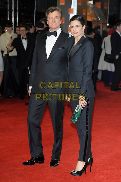 Colin Firth and Livia Giuggioli.The Orange British Academy Film Awards ( BAFTA ), Royal Opera House, Bow St., London, England..February 12th, 2012.baftas full length black white tuxedo shirt sheer suit married husband wife green clutch bag side holding hands .CAP/PL.©Phil Loftus/Capital Pictures.