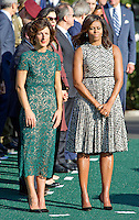 First lady Michelle Obama and Mrs. Agnese Landini of Italy listen to remarks during the Official Arrival Ceremony on the South Lawn of the the White House in Washington, DC on Tuesday, October 18, 2016. <br /> Credit: Ron Sachs / CNP /MediaPunch