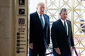 US President Donald J. Trump (L) and Chief Justice John Roberts (R) walk together as the late US Supreme Court Justice John Paul Stevens lies in repose in the Great Hall of the Supreme Court, in Washington, DC, USA, 22 July 2019. Stevens, who served on the Supreme Court for nearly thirty-five years, died at age ninety-nine, 16 July.<br /> Credit: Michael Reynolds / Pool via CNP
