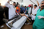 A Palestinian protester who was wounded during clashes with Israeli froces at the Israel-Gaza border, receives treatment at a medical tent, in Khan Younis in the southern Gaza Strip on October 19, 2018. Photo by Ashraf Amra
