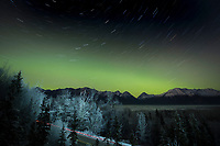 Northern Lights, Aurora Borealis, over Chugach Mountains and Knik River Valley Alaska   with car lights on road<br /> <br /> Photo by Jeff Schultz/SchultzPhoto.com  (C) 2016  ALL RIGHTS RESVERVED