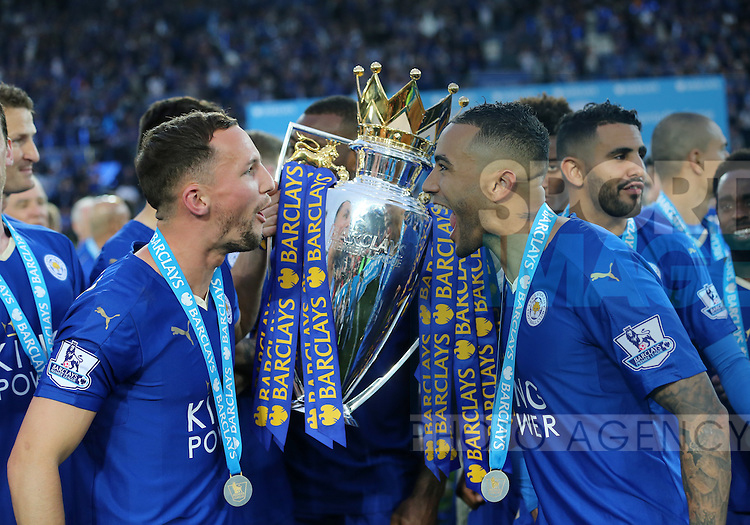 Leicester's Danny Drinkwater and Danny SImpson celebrate with the trophy during the Barclays Premier League match at the King Power Stadium.  Photo credit should read: David Klein/Sportimage