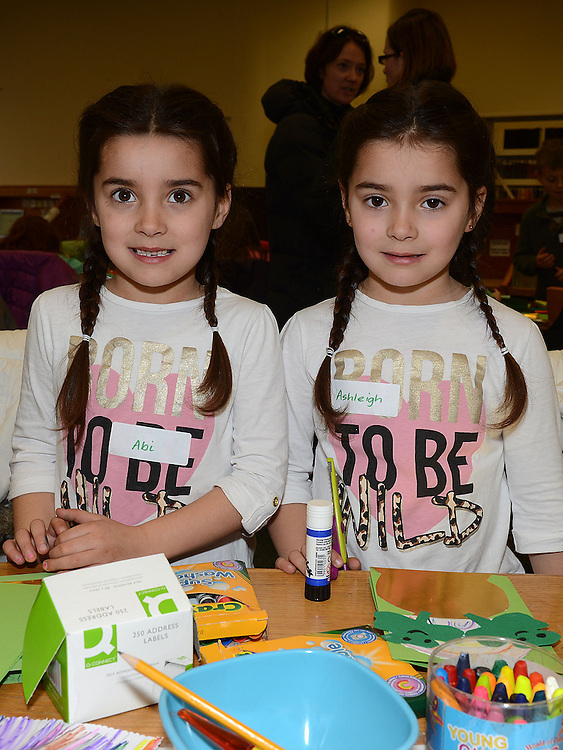 Abbi and Ashleigh Carton Smith pictured at the St Patrick's day art and craft session in the library. Photo:Colin Bell/pressphotos.ie