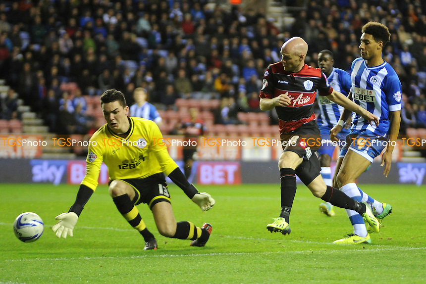 Andy Johnson of Queens Park Rangers tries to flick the ball past Lee Nicholls of Wigan Athletic - Wigan Athletic vs QPR - Sky Bet Champiosnhip Football at the DW Stadium, Wigan - 30/10/13 - MANDATORY CREDIT: Greig Bertram/TGSPHOTO - Self billing applies where appropriate - 0845 094 6026 - contact@tgsphoto.co.uk - NO UNPAID USE