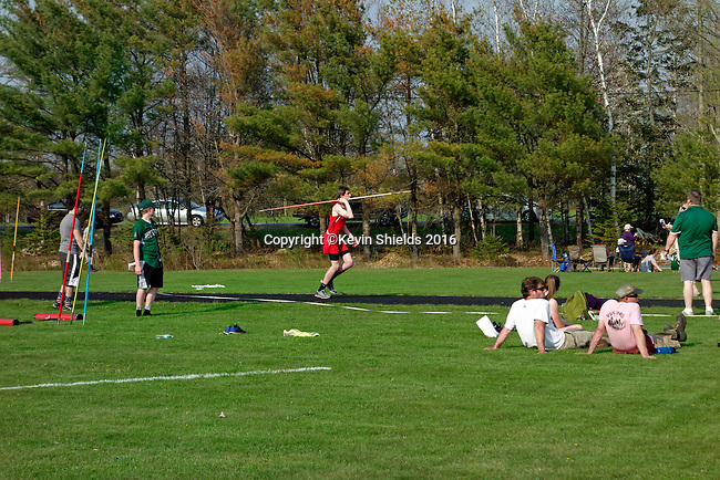 Javelin throw at a high school track meet.