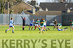 Aislinn Desmond breaks out of the Kerry defence as referee Niall McCormack indicates advantage to her as she's been fouled by the Waterford forwards in the LGFA National football league in Strand Road on Saturday.