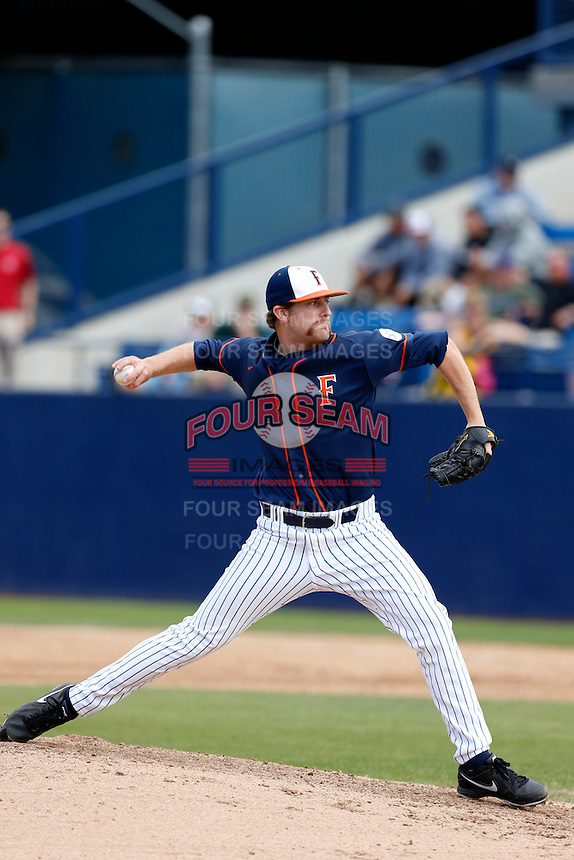 Grahamm Wiest #12 of the Cal State Fullerton Titans pitches against the Oregon Ducks at Goodwin Field on March 3, 2013 in Fullerton, California. (Larry Goren/Four Seam Images)