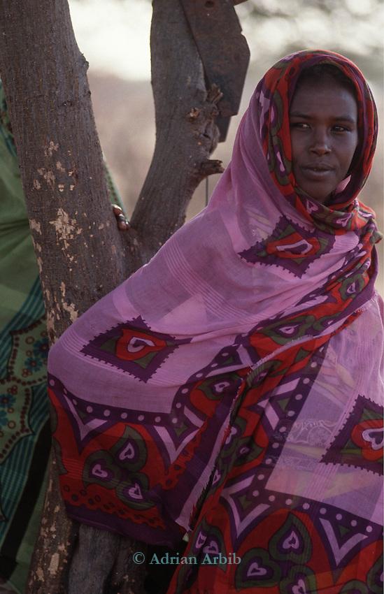 Somali woman at feeding station, Wajir, Somaliland, Kenya
