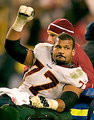 Landover, MD - December 18, 2005 -- Washington Redskin right guard Randy Thomas (77) acknowledges cheers of the 90,588 fans as he leave the field after he fractured his right ankle in the fourth quarter against the Dallas Cowboys at FedEx Field in Landover, Maryland on December 18, 2005.  The Redskins won the game 35 - 7..Credit: Ron Sachs / CNP