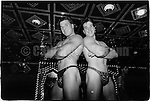 1990s:  Twin male strippers at Big Top club in Times Square, New York City.