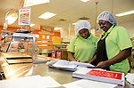 Food Service Attendants Wanda Watson and Ryneshia Cosey review the menu before preparing the first meal of the school year.