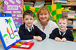 Junior infants Oisin O'Connor left and Thomas Joy with their Pricipal Angela Prendergast at Fybough NS, Castlemaine on Wednesday