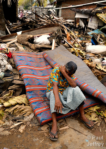 A woman whose home was destroyed by the South Asian tsunami sits in despair amidst the wreckage in the town of Moratuwa, south of Colombo, Sri Lanka's capital. The December 26, 2004, tsunami left devastation behind along most of the island nation's coastline.